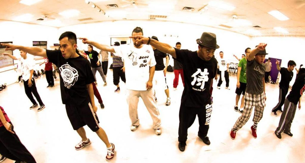 photography of locking dancers practicing